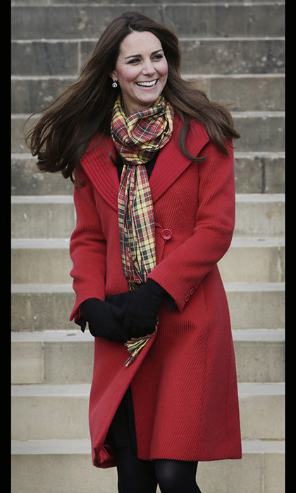 On tour in Scotland, the duchess donned a red Armani coat, black gloves and a red-and-yellow tartan scarf. Photo: © Getty