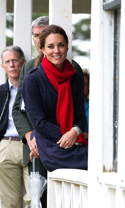 While on tour in Canada, the duchess kept warm in a patriotic red scarf. Photo: © Getty