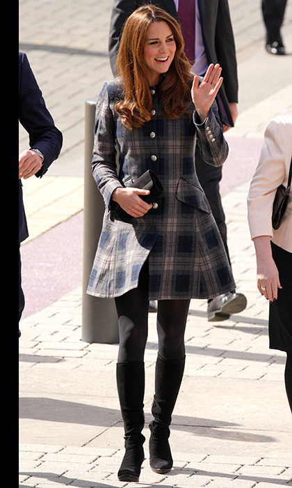 In Glasgow, she was warm yet stylish in a blue tartan Moloh coat and grey tights. Photo: © Getty