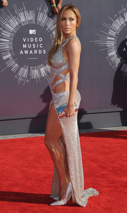 "Jennifer Lopez: She's not afraid to show off her best ""assets,"" especially in the video for ""Booty,"" and the sultry Versace dress she donned at the 2000 Grammy Awards is going down in bombshell history. (Image: Getty)"