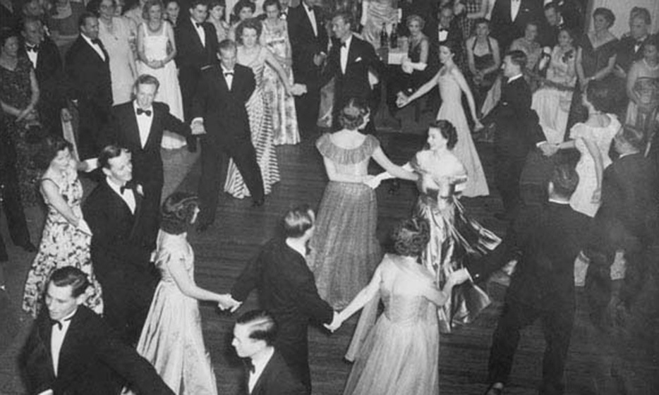 The royal couple hit the floor to dance an eightsome reel at the Saddle Club, where Queen Elizabeth II linked arms with Lady Pamela Mountbatten, first cousin of the merry Duke of Edinburgh, who also took part. Photo: © Illustrated London News Ltd/Mary Evans
