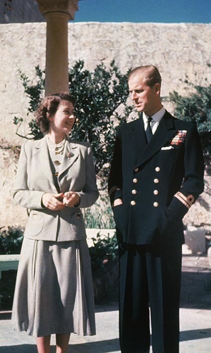The Queen is seen gazing adoringly at her handsome husband in his naval uniform. Philip was stationed in Malta as a naval officer before the Queen's succession, which is why they lived there briefly as a young married couple. Photo: © Hulton Archive/Getty Images