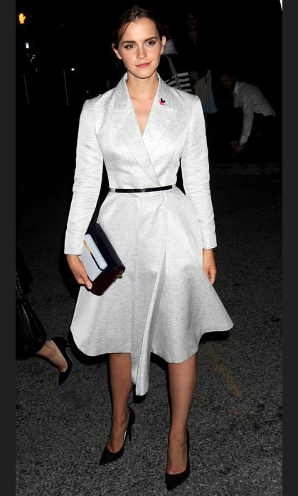 Power dressing in a white belted dress-suit for her UN speech.