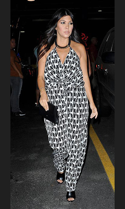 Choosing a bold printed jumpsuit as she headed to sister Khloe's birthday party on a boat.
