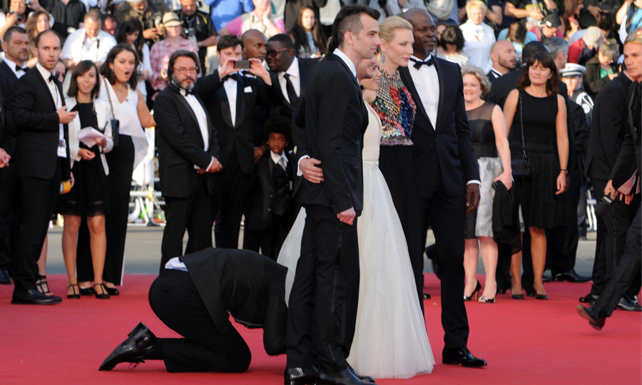 "At the 2014 Cannes Film Festival, Vitalii's definition of ""prank"" took a perverse turn when he crawled under America Ferrera's skirt at the premiere of 'How to Train Your Dragon 2.' (Image: Traverso/Getty Images)"