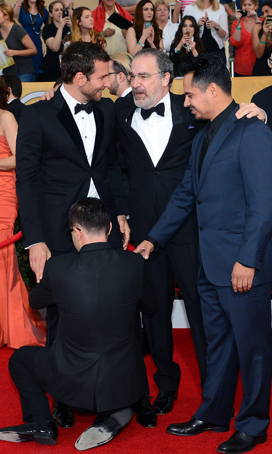 In January 2014, he attended the 20th annual Screen Actors Guild Awards and debuted a new prank: the groin hug. Vitalii rushed Bradley Cooper on the red carpet and clung on to the actor's waist until he was pried off by handlers. (Image: Ethan Miller/Getty Images)