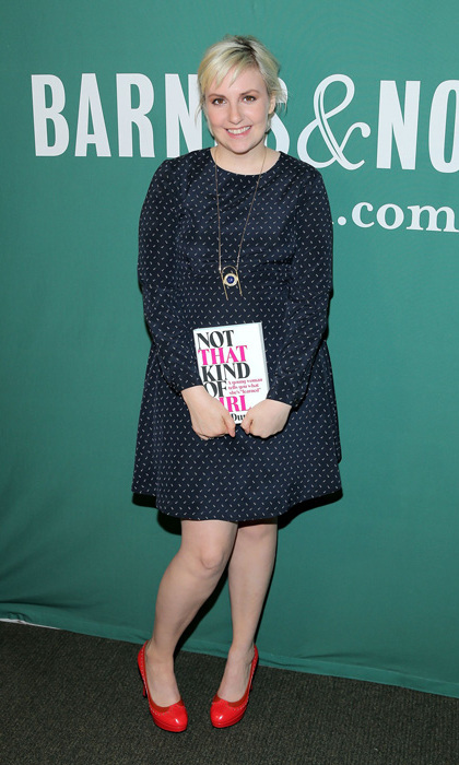 'Girls' creator and recently published author Lena Dunham opted for a whimsical printed frock and bright red heels to promote her memoir, 'Not That Kind of Girl,' in New York City.