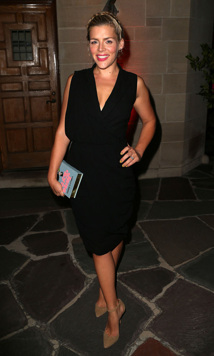 Busy Phillips attended the LaxArt biannual gala in a black wrap dress, suede ankle-strap pumps and a Kate Spade clutch.