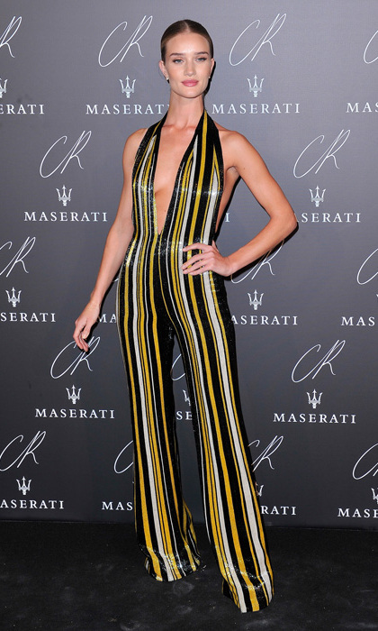 Rosie Huntington-Whiteley brought it back 70s style at the Carine Roitfeld Fashion Book party in Paris in a disco-esque halter jumpsuit by Balmain and slicked back `do.