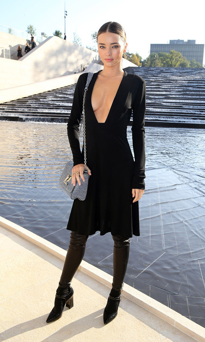 Miranda Kerr took the ultimate plunge in a deep cut LBD, thigh-high leather boots and a denim-blue Louis Vuitton handbag.