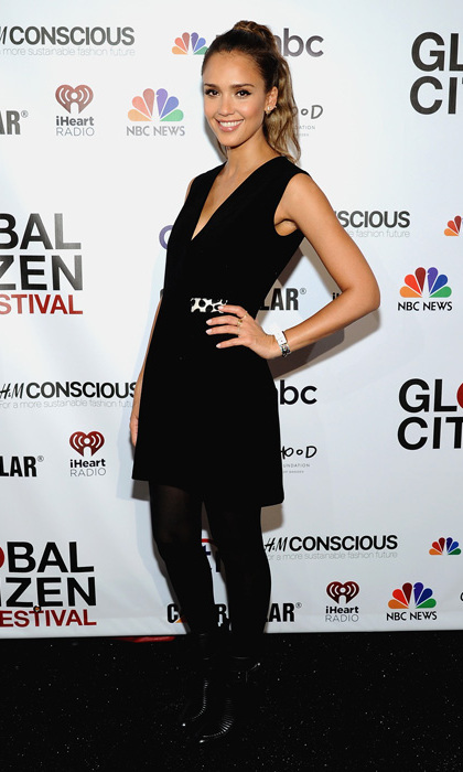 Jessica Alba attended the Global Citizen Festival wearing a sleeveless wrap dress by Edun with a calf-hair belt and Rachel Zoe's Sanderson boots.
