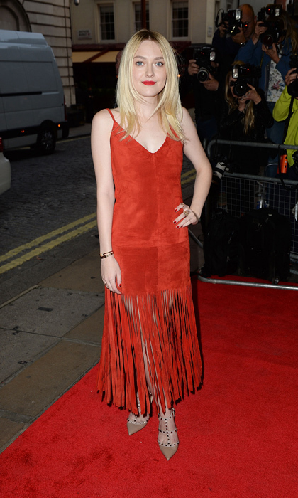 Dakota Fanning opted for a '60s inspired Valentino look for the 'Effie Gray' premiere, pairing her suede fringe dress with the designer's Rockstud heels and a bright red lip.